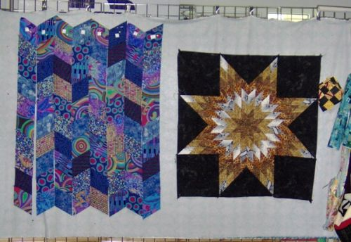 Quilt projects hung on movable frame walls