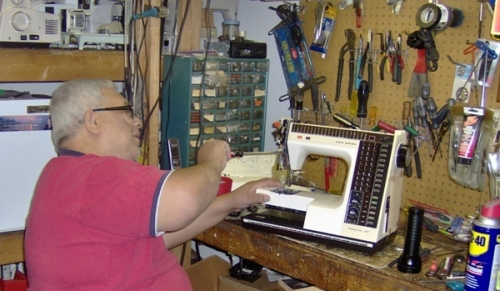 Dave at repairing a sewing machine