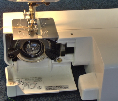 Guide inside the drop down door for cleaning and winding bobbin