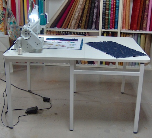 A goose neck lamp attached to the table