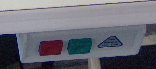 a pair of green and red push buttons